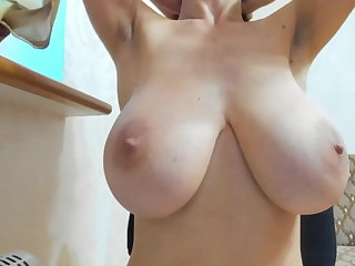 Lactating Drinking milk from huge natural breast