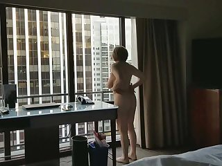 Big Butts Mature hottie naked in hotel window